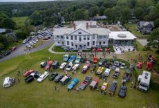 Two dozen classic vehicles are clustered on the lawn of the Martha's Vineyard Museum in this aerial shot by Joshua Robinson-White.