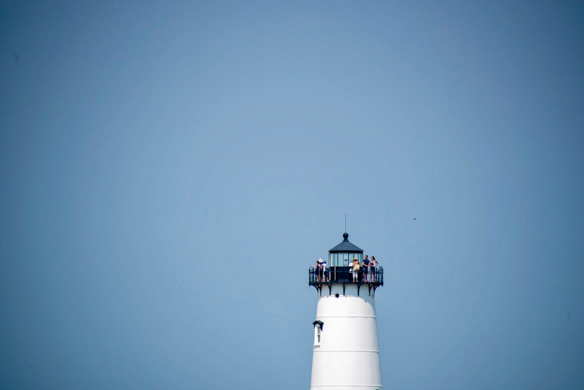 Tourists take in the view from atop Edgartown Lighthouse.